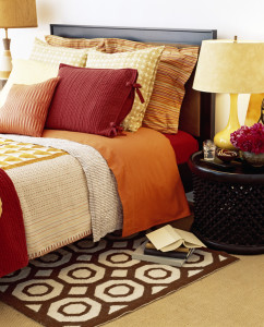 Pillows Resting on a Bed in Warm, Comfortable Bedroom